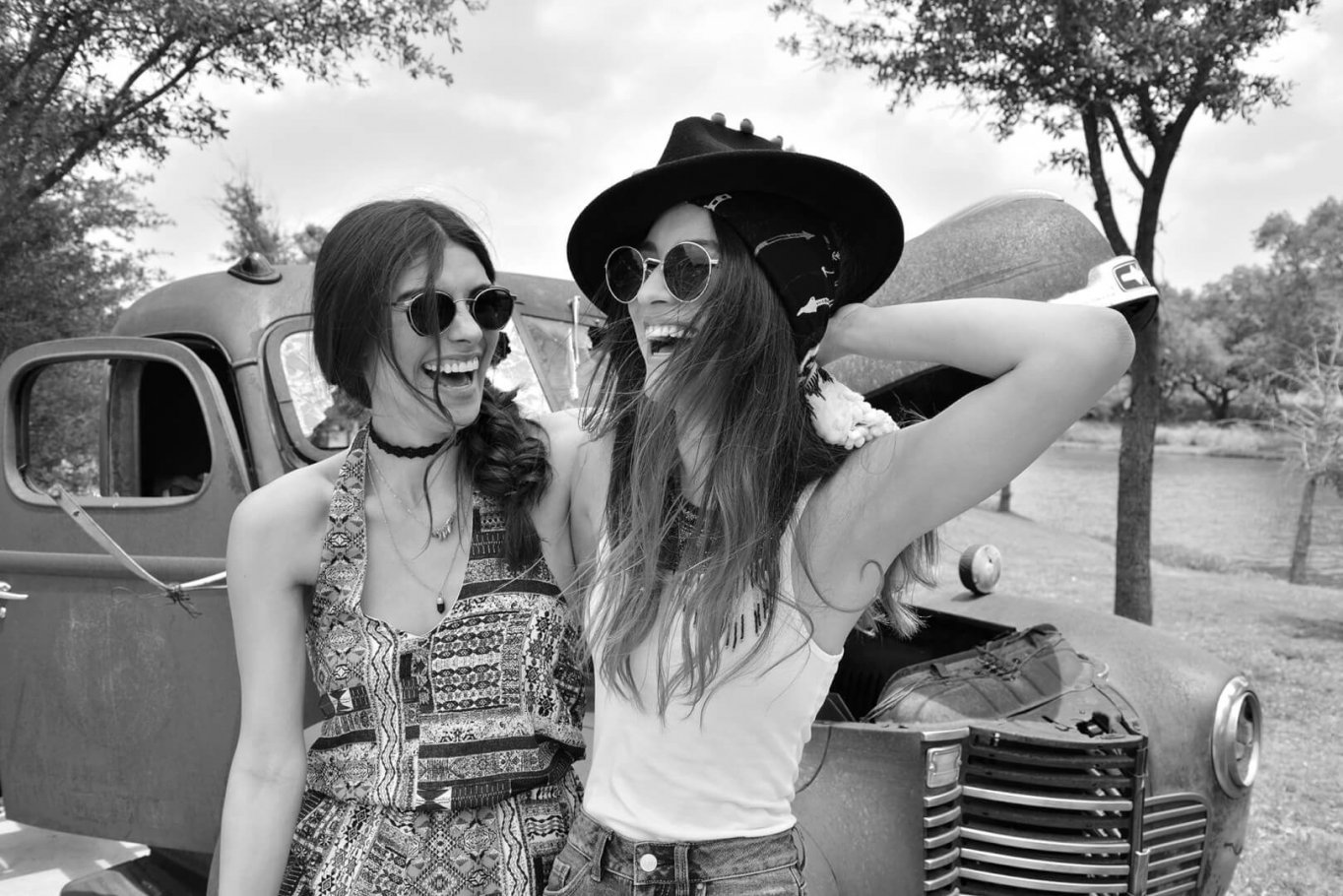 beautiful girls laughing in black and white
