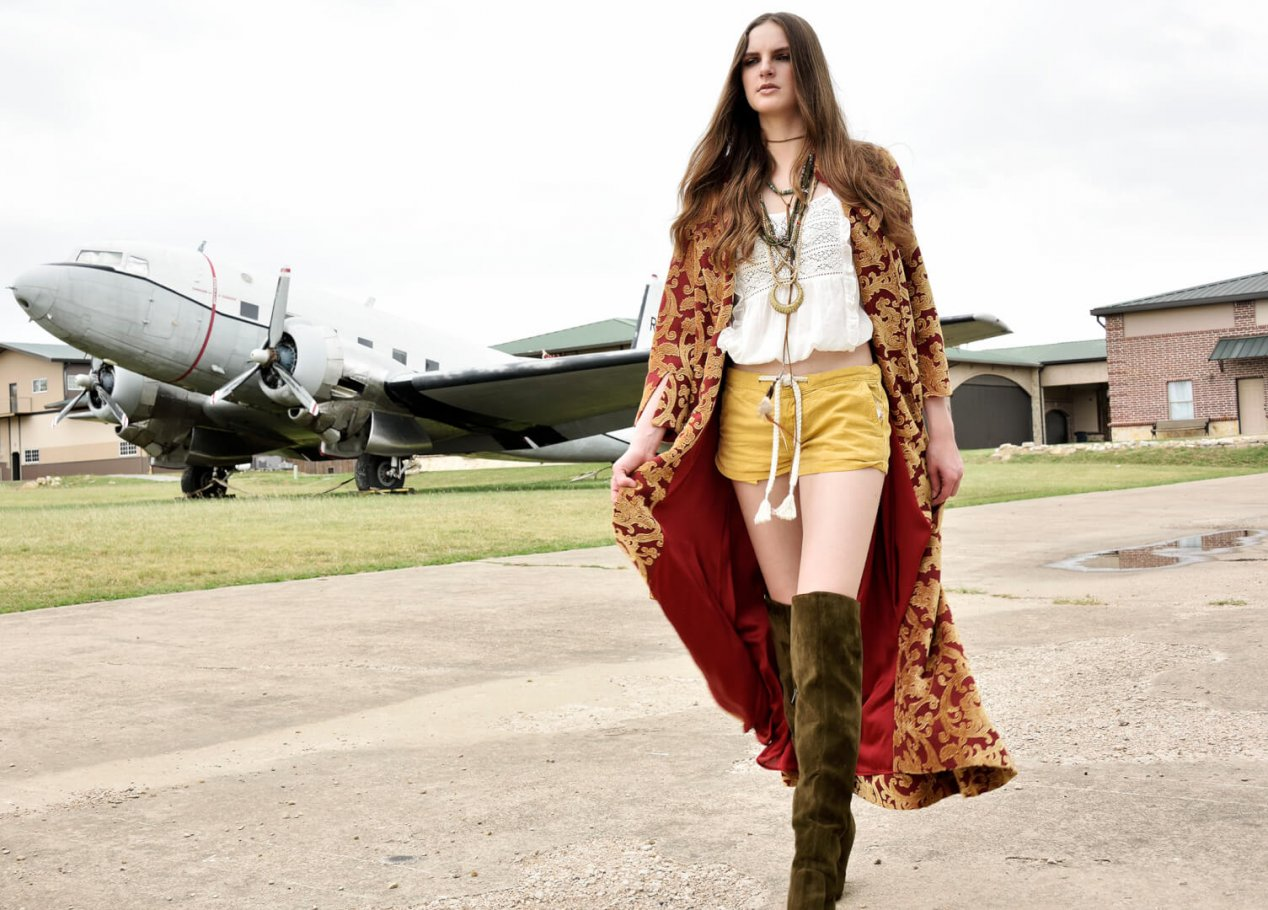 beautiful girl by vintage plane