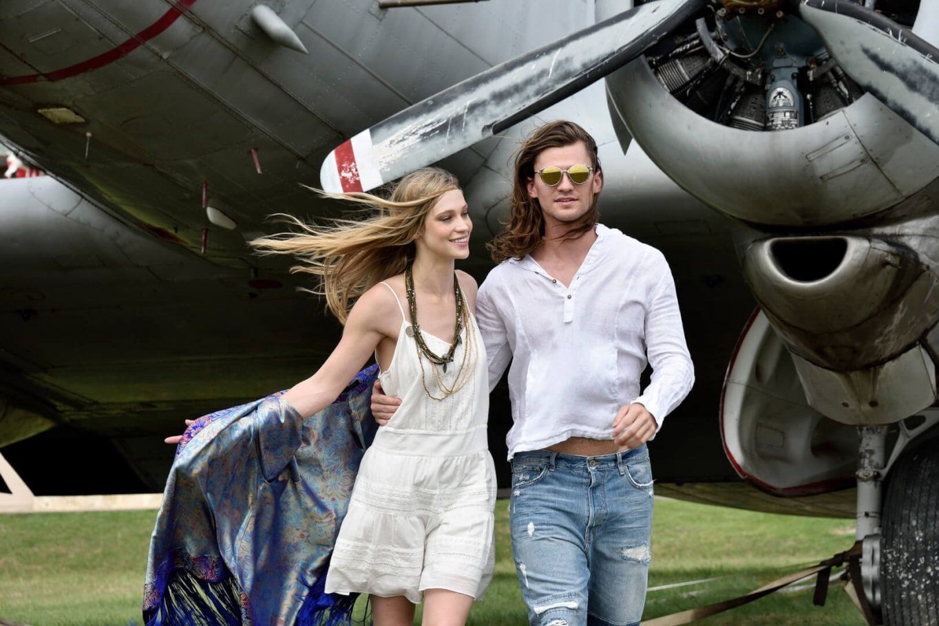 beautiful couple with vintage plane