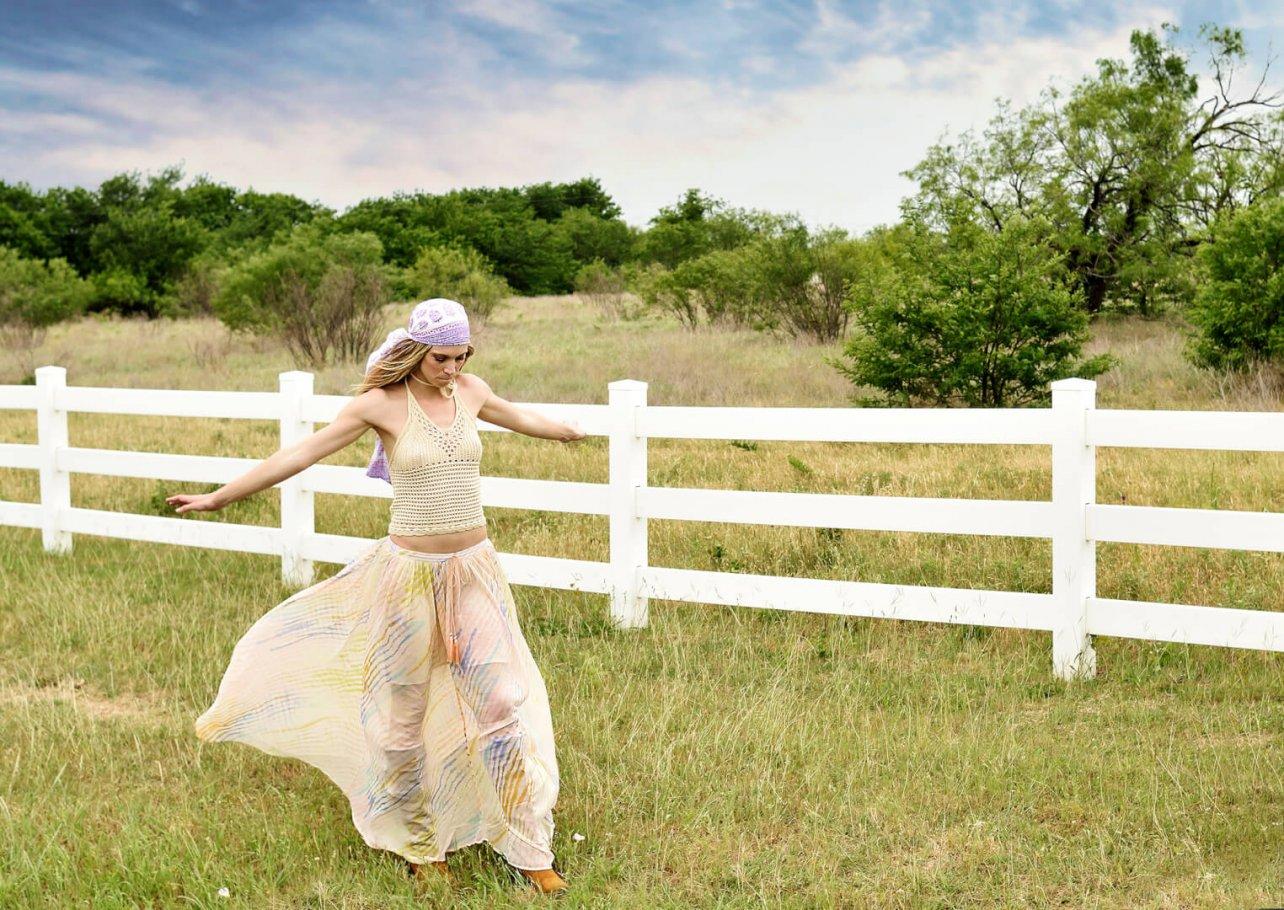 beautiful girl walking in grass