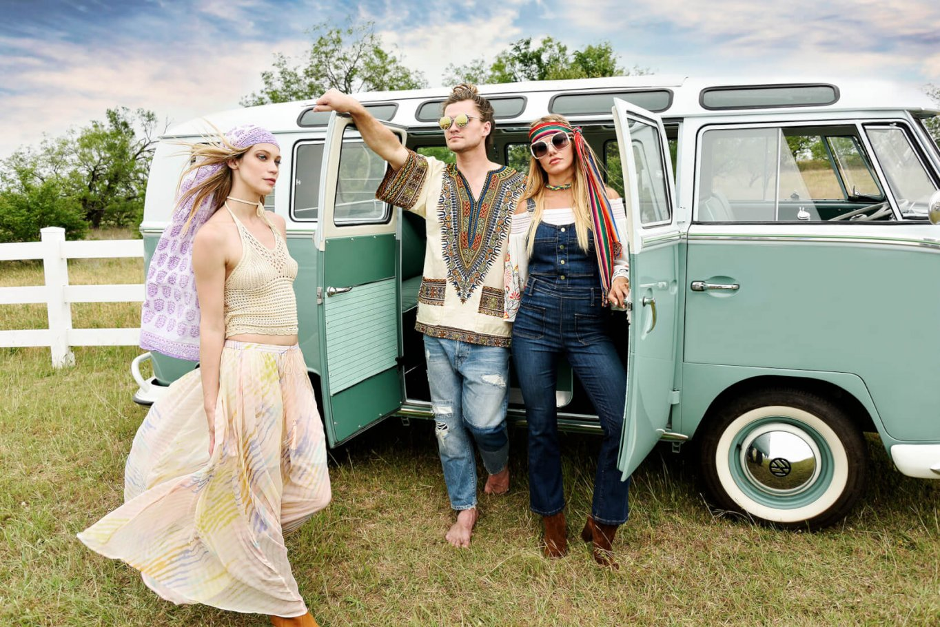 beautiful girl and young couple dressed as hippies with vintage VW